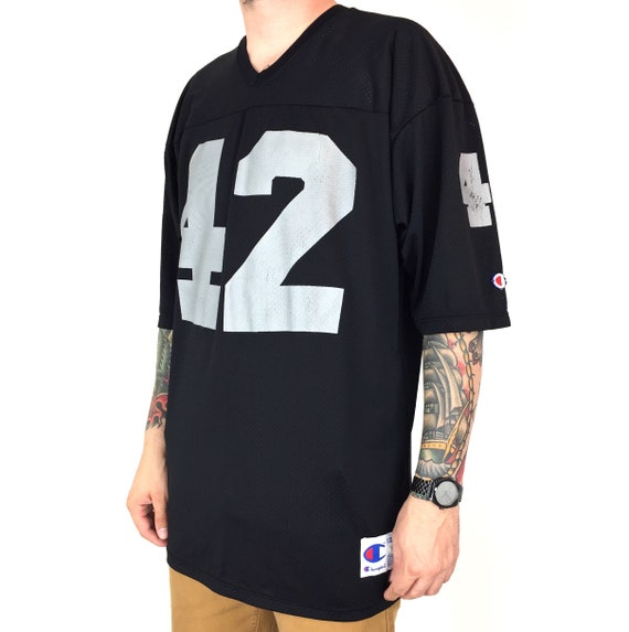Vintage 90s Champion NFL Los Angeles Oakland Raiders Ronnie Lott #42 Made in USA black football jersey - Size 48 / XL