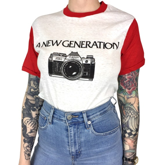 Rare Deadstock Vintage 70s Canon A New Generation Baseball single stitch photo photography camera graphic tee t-shirt shirt - Size XS