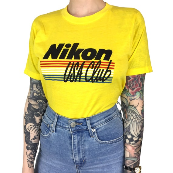 Rare Deadstock Vintage 80s Nikon USA Club Worlds Greatest Pictures Screen Stars photography camera graphic tee t-shirt shirt - Size XS