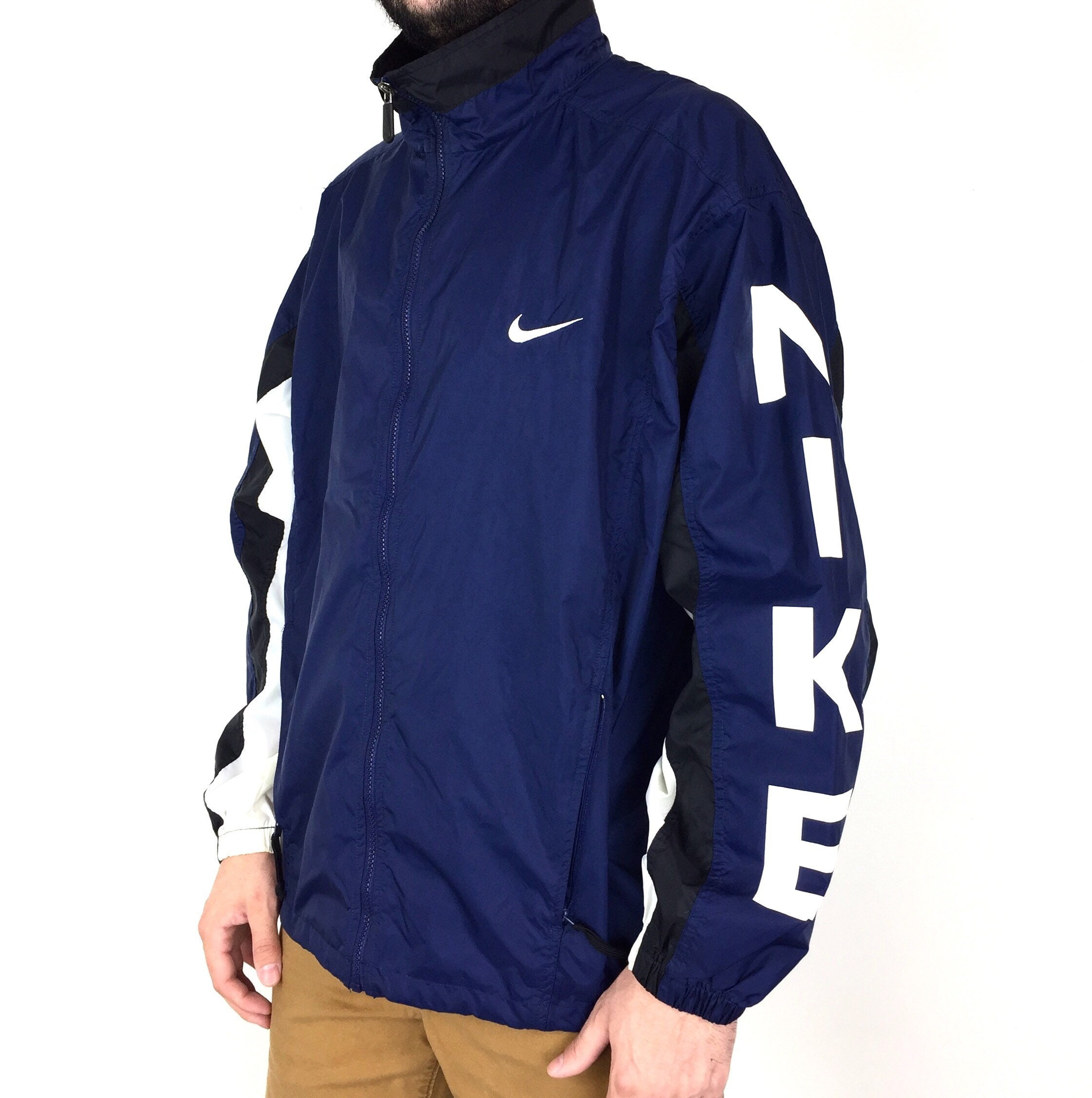 5ecc127e66 Rare Vintage 90s Nike grey silver tag navy blue double sleeve arm spell out  zip up lightweight windbreaker jacket - Size XL