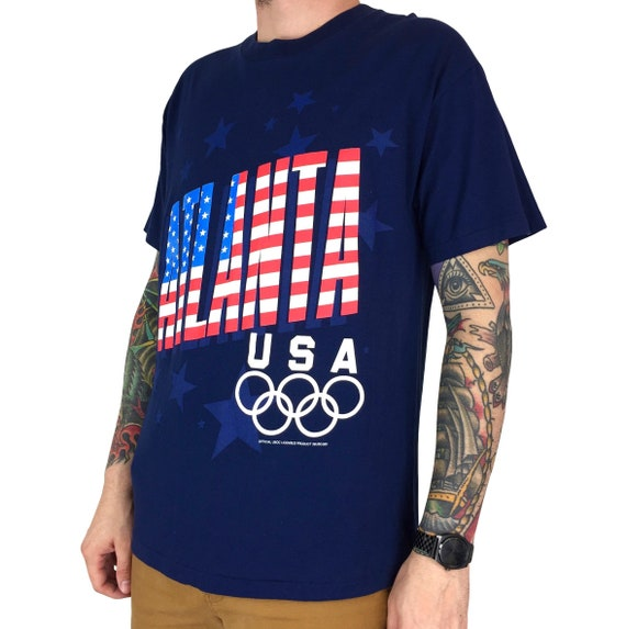 Vintage ATL 1996 96 Atlanta Olympics Olympic Games Champion blue Team USA single stitch Made in USA graphic tee t-shirt shirt - Size M
