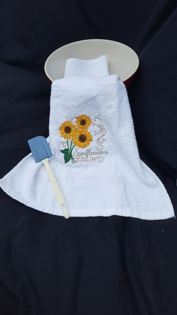 Welcome the spring into your home with this sunflower hand towel in your bathroom or kitchen, or warm up someone else's home as a gift