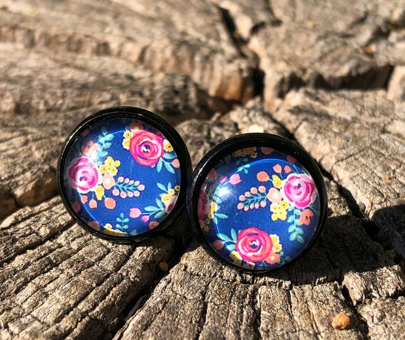 Black earrings with pink blossoms on dark blue floral image 0