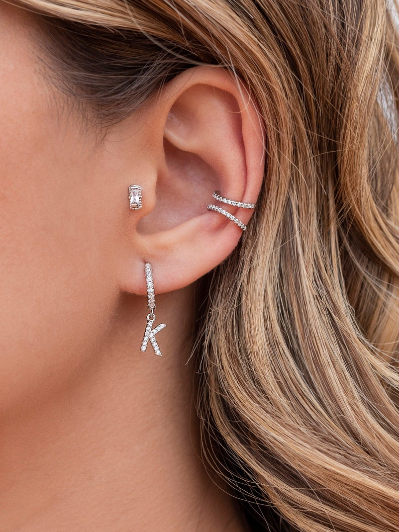 Hoop earrings with stones and initial letter hanging with stones