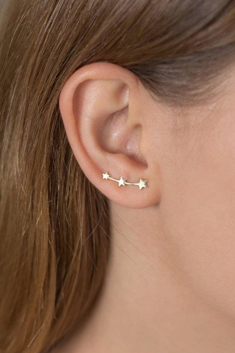 e95685397ddd Pendiente trepador con estrellas Pendientes de estrella ear