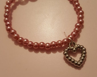 child's bracelet with heart charm