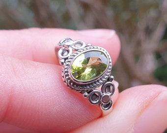 Peridot ring cut from solid silver