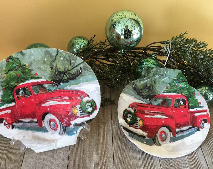 vintage pickup dog truck ornament in the snow bernese mountain dog old red truck