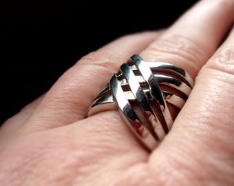 Ring, stainless steel, finger ring, cuts, perforations, pattern, braid