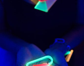 Neon Futuristic Geometric black light reactive dance accessory styled as a knuckle multi finger ring - in Orangesicle