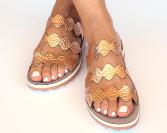 Pink gold sandals with zick design, Bubble patterned sole pairs with the signature flexible design for all day comfort and ease