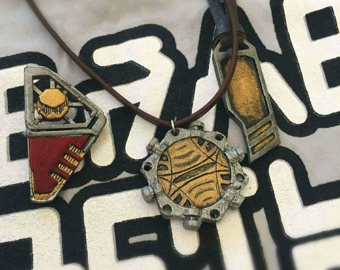 Star Lord pendants and lapel pin