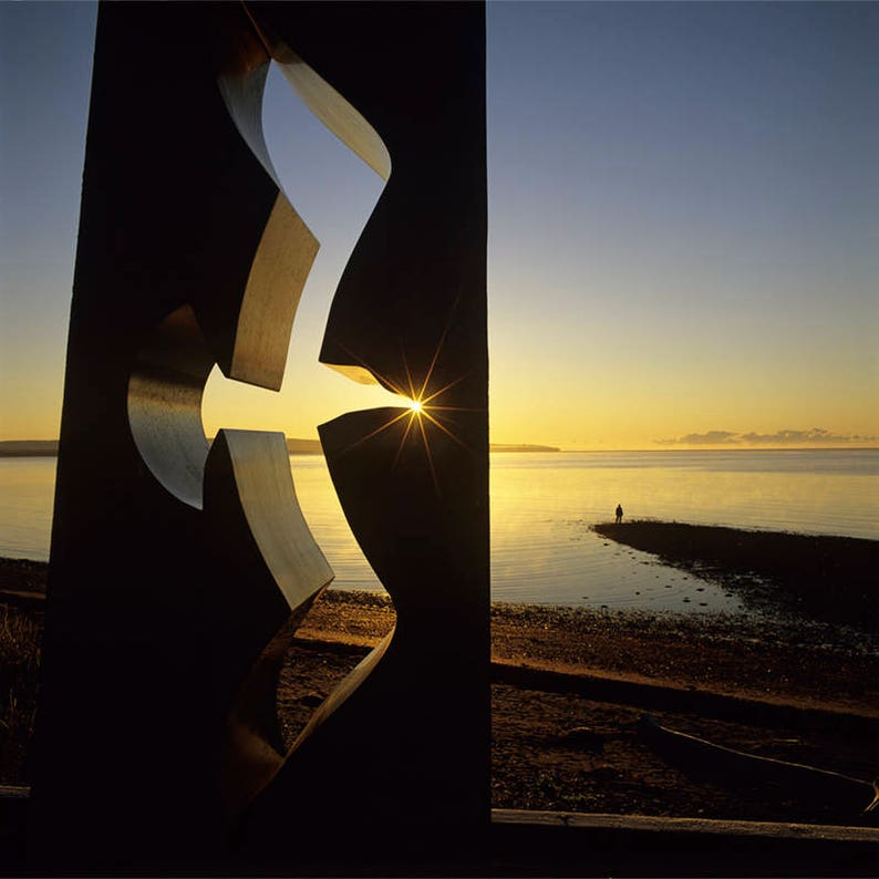 Gaspe Coast Gulls sculpture at Maria at sunrise and walker on the beach