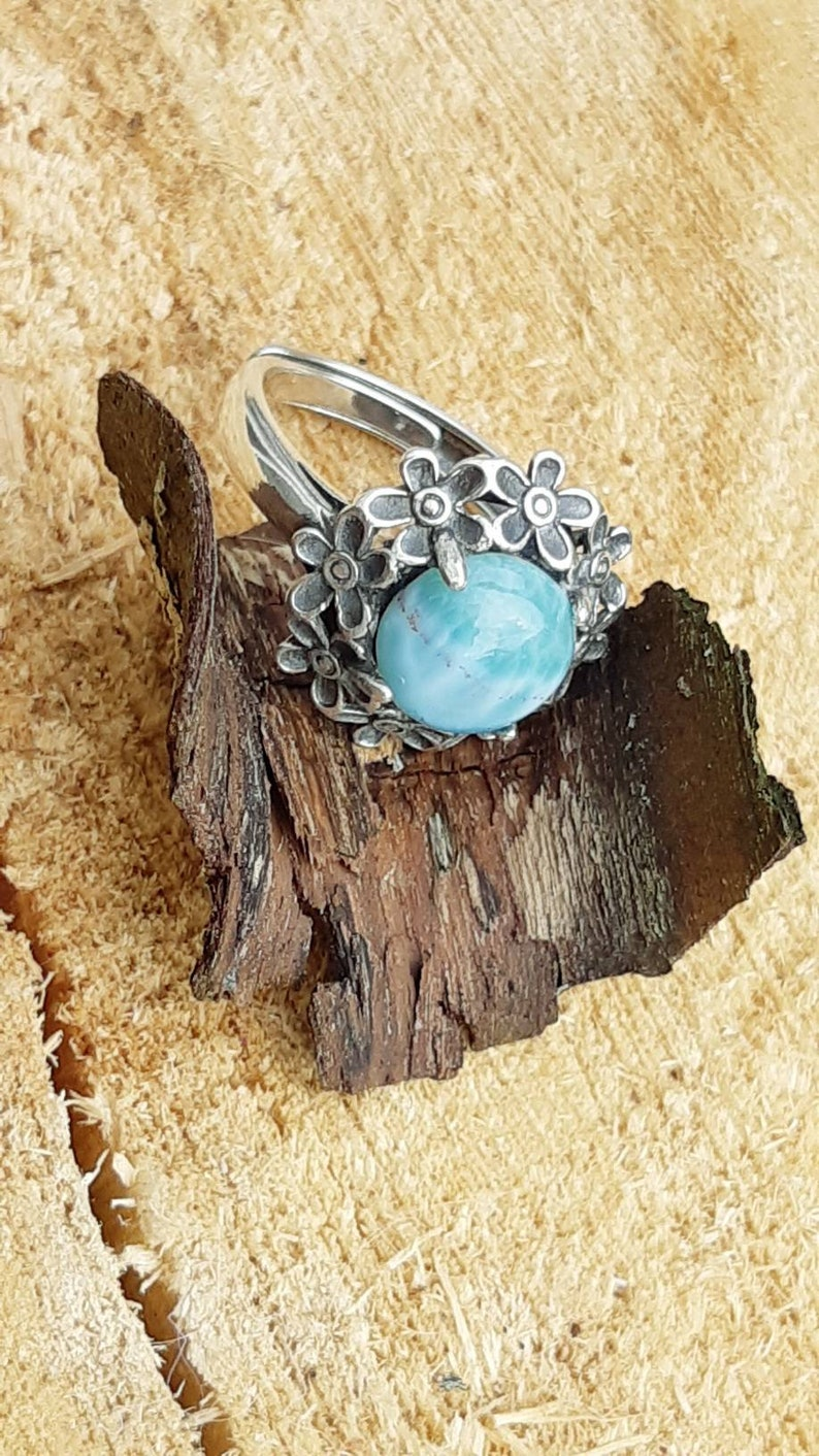 Also known as the Atlantis or Dolphin stone Gives Spiritual and spiritual strength. Larimar adjustable ring from the Dominican Republic