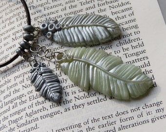 Boho hippie polymer clay feather necklace in blue and silver