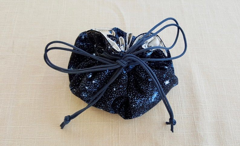 Tan Thread Cosmic Circular Cinch Bag