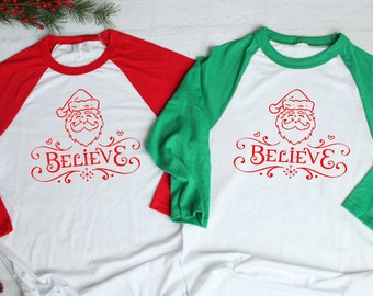 d6d29c53a Believe in Santa Clause! Woman's womens Christmas Raglan shirt baseball tee  red green sleeves in XS - 4XL ladies and plus size