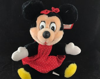 "Vintage Walt Disney World and Disneyland exclusive Minnie Mouse Plush. 7"" tall complete with hangtag."