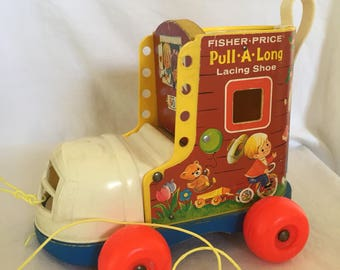 Vintage Fisher Price Little People Pull A long Shoe.
