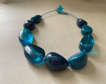 Blue design necklace with large beads.