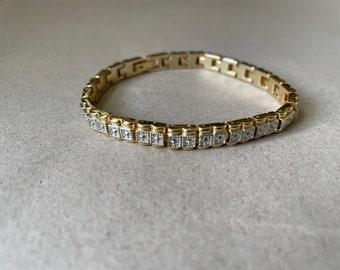 Gold vintage link bracelet with silver embellishment.