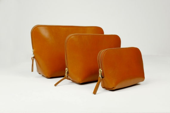 Cosmetic Bags, Three Sizes with Zipper, Genuine Leather, Color Cognac