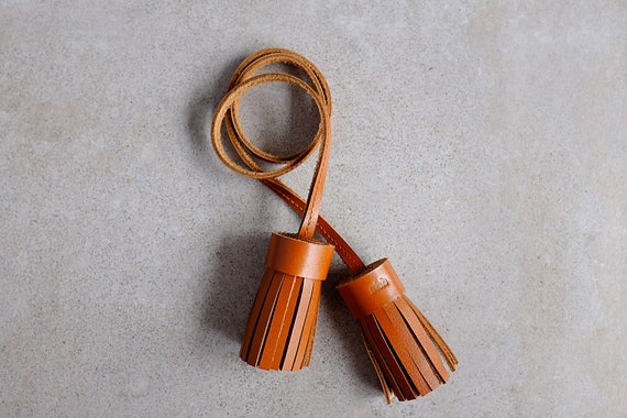 Double MUGL, tassel in cognac genuine leather