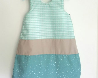 Sleeping baby boy 0-6 months baby sleeper bag patterns geometric inspired Scandinavian pastel color. Personalized with the name.