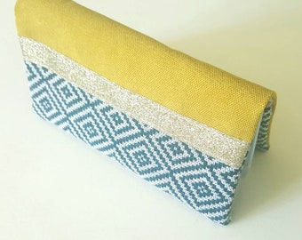Glittery rigid suede mustard and teal fabric checkbook cover with geometric patterns