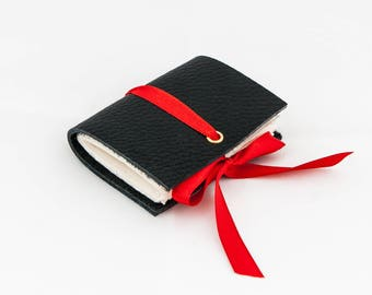 Mini leather notebook made with recycled paper