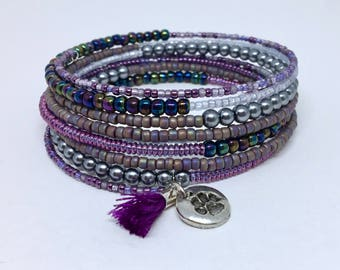 Violet cuff bracelet with tassel and dog paw charm