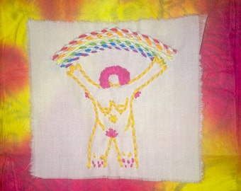 Woman with rainbow embroidery