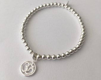 Sterling Silver stretch bracelet with Ohm charm