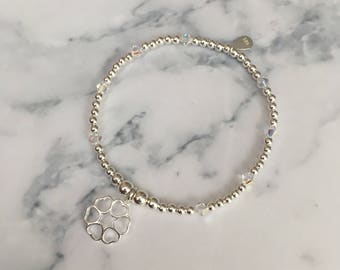 Sterling Silver stretch bracelet with Swarovski Crystal Bicone Beads and Flower of Hearts charm