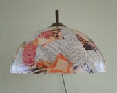 Wall lamp with worked lam...