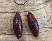 Earrings: Pendants of red...