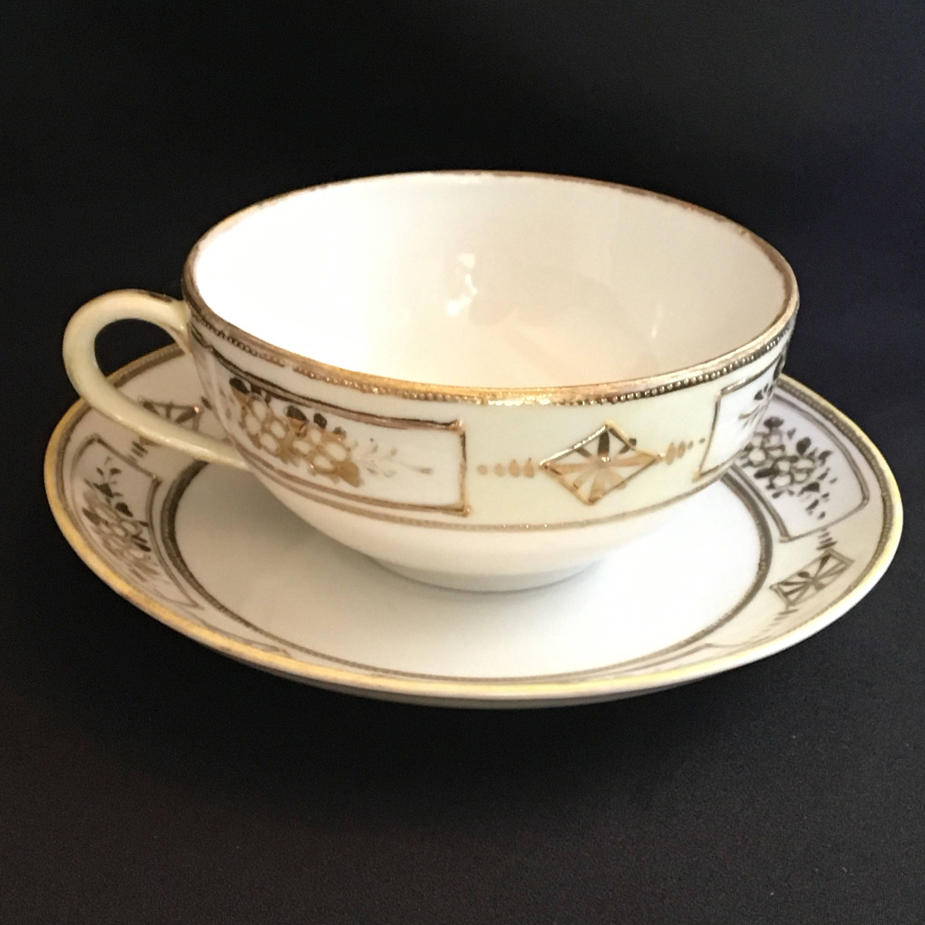 Vintage 1940 era handpainted Japanese porcelain raised gilded cup and saucer
