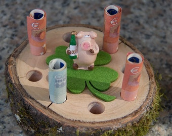 Tree slice with lucky pig as a gift of money