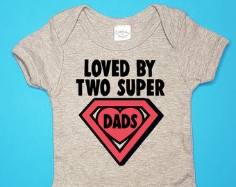 7a10f45af05 Loved By Two Super Dads Infant   Baby Bodysuit or Toddler T-Shirt