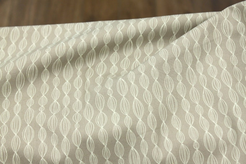 by the 0.5m 1.5m wide Geometric Floral Print Cotton Elastane Jersey Fabric