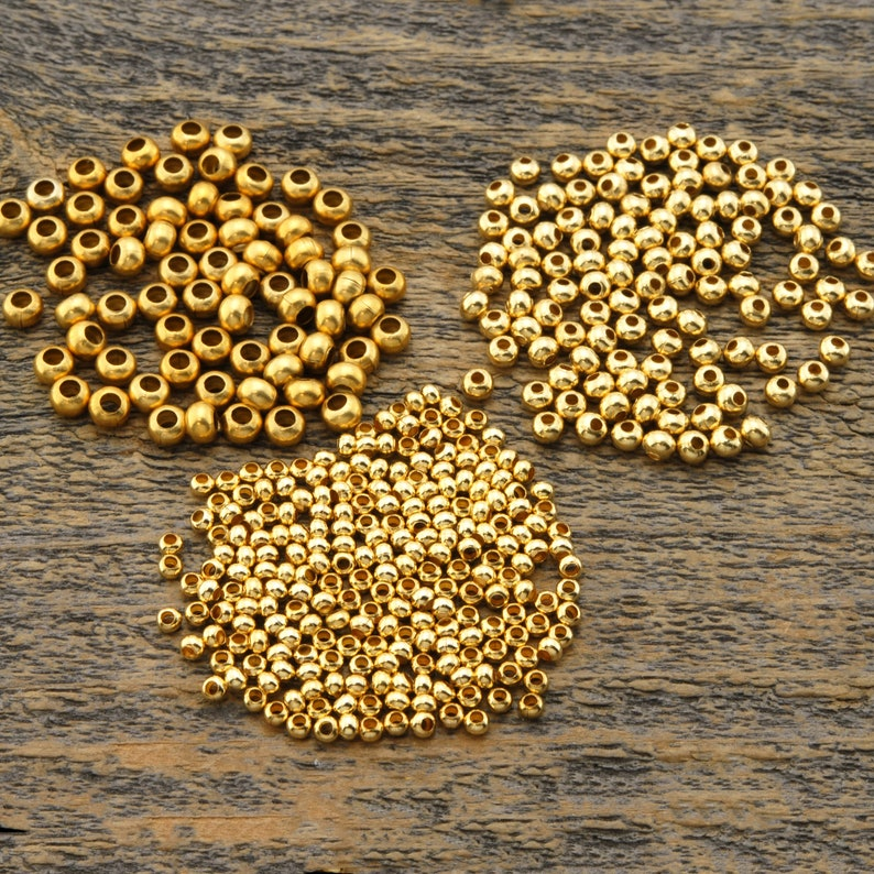 gold plated brass Irina Miech Metal seed bead assortment three tubes assorted size 6 8 and 11