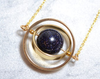Spinning little planet with 12mm Goldstone gold necklace