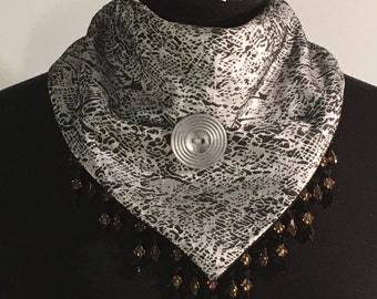 Scarf with snap closure