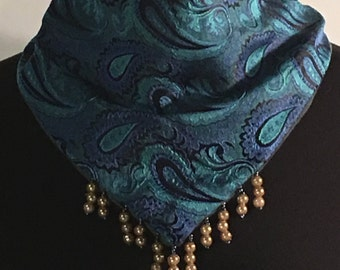 Scarf with a snap closure in back