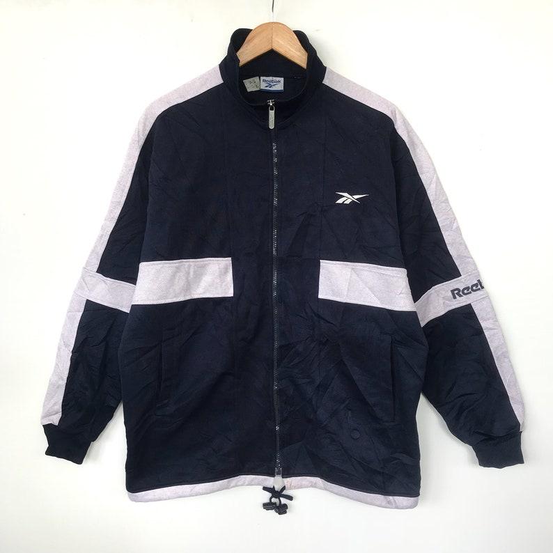 f744a7e1220fd Rare vintage 90s REEBOK track top spellout jacket/dark | Etsy