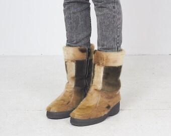 d3c9bcc15f2 Vintage fur boots | Etsy