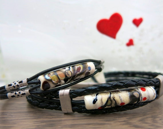 All bracelets for lovers of leather and glass bead.