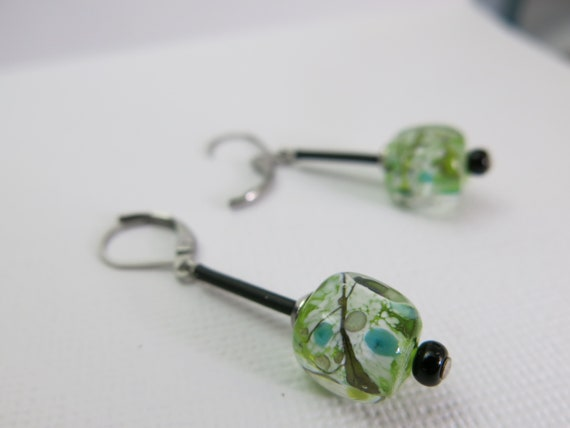 Single glass earrings spun with a blowtorch. Glass tint, black and white.