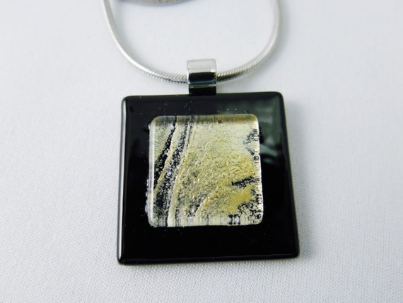 "Pendant glass with stainless steel chain. from a 18 ""."