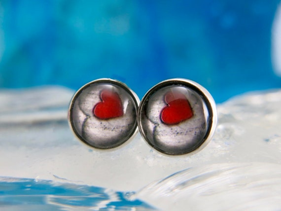 12mmx12mm glass ear chips.  Stainless steel stem. Hypoallergenic.